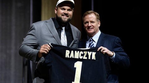 Wisconsin's Ryan Ramczyk, left, poses with NFL commissioner Roger Goodell after being selected by the New Orleans Saints during the first round of the 2017 NFL football draft, Thursday, April 27, 2017, in Philadelphia. (AP Photo/Matt Rourke)