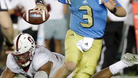 FILE - In this Sept. 24, 2016, file photo, UCLA quarterback Josh Rosen throws against Stanford during the second half of an NCAA college football game in Pasadena, Calif. Oregon running back Royce Freeman, USC quarterback Sam Darnold and UCLA quarterback Josh Rosen are among the Pac-12 players to keep an eye on coming out of spring practice. (AP Photo/Chris Carlson, File)