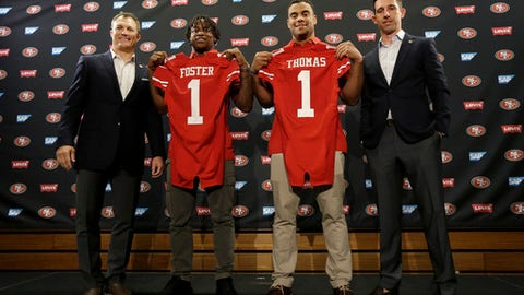 From left to right, San Francisco 49ers general manager John Lynch poses for photos with draft picks Reuben Foster, Solomon Thomas and head coach Kyle Shanahan at a news conference in Santa Clara, Calif., Friday, April 28, 2017. (AP Photo/Jeff Chiu)