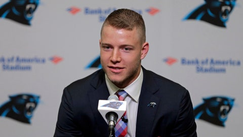 Carolina Panthers first-round draft pick Christian McCaffrey answers a question during a news conference in Charlotte, N.C., Friday, April 28, 2017. (AP Photo/Chuck Burton)