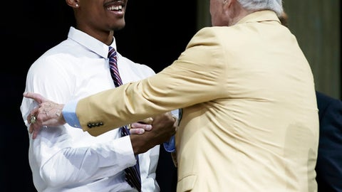 Washington's Kevin King, left, greets former Green Bay Packers Jim Taylor after King was selected by the Packers during the second round of the 2017 NFL football draft, Friday, April 28, 2017, in Philadelphia. (AP Photo/Matt Rourke)