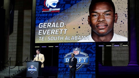 Former Los Angeles Rams player Jack Youngblood, left, announces South Alabama's Gerald Everett as the Rams' selection in the second round of the 2017 NFL football draft, Friday, April 28, 2017, in Philadelphia. (AP Photo/Matt Rourke)