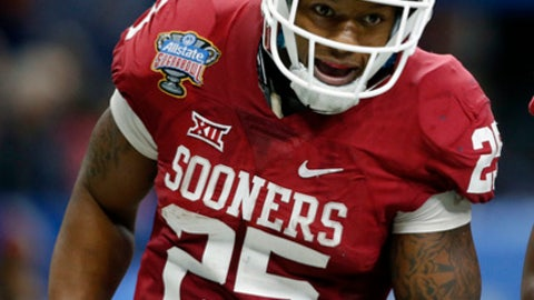 FILE - In this Jan. 2, 2017, file photo, Oklahoma running back Joe Mixon (25) celebrates his touchdown against Auburn in the first half of the Sugar Bowl NCAA college football game in New Orleans. Fans in the NFL draft theater booed when Mixon, who was uninvited to the scouting combine because of a domestic assault incident from 2014, was announced as the Cincinnati Bengals' pick at No. 48 overall Friday, April 28, 2017. (AP Photo/Gerald Herbert, File)