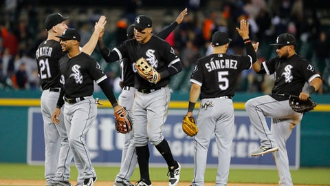 Chicago White Sox players celebrate their 7-3 win against the Detroit Tigers after a baseball game in Detroit, Friday, April 28, 2017. (AP Photo/Paul Sancya)