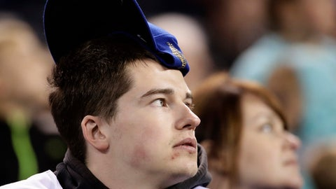 A Kansas City Royals fan wears a rally cap during the ninth inning of a baseball game against the Minnesota Twins Friday, April 28, 2017, in Kansas City, Mo. The Twins won 6-4. (AP Photo/Charlie Riedel)