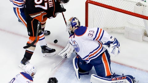 Edmonton Oilers goalie Cam Talbot, right, blocks a shot by Anaheim Ducks center Rickard Rakell during the second period in Game 2 of a second-round NHL hockey Stanley Cup playoff series in Anaheim, Calif., Friday, April 28, 2017. The Oilers won 5-3. (AP Photo/Chris Carlson)