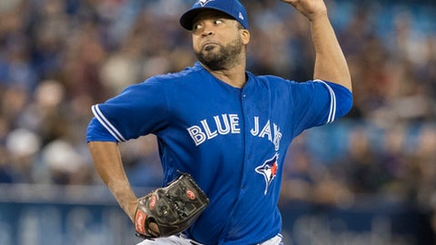 Toronto Blue Jays starting pitcher Francisco Liriano throws against the Tampa Bay Rays during the first inning of a baseball game in Toronto on Saturday April 29, 2017.  (Fred Thornhill/The Canadian Press via AP)