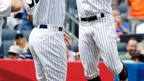 New York Yankees' Brett Gardner, right, celebrates with teammate Aaron Judge (99) after Gardner hit a  3-run home run during the second inning of a baseball game against the Baltimore Orioles, Saturday, April 29, 2017, in New York. (AP Photo/Frank Franklin II)