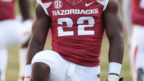 FILE - In this Oct. 15, 2016, file photo, Arkansas running back Rawleigh Williams III stretches before an NCAA college football game against Mississippi in Fayetteville, Ark. Williams was carted from the field after an injury during the team's final spring practice on Saturday, April 29., 2017. The nature of the injury was not immediately clear.  (AP Photo/Chris Brashers, File)
