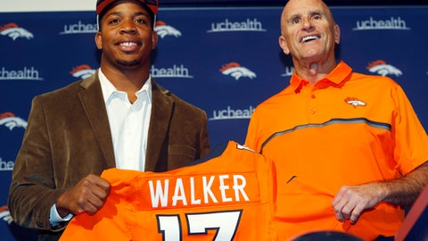 Denver Broncos defensive end DeMarcus Walker, who was the team's second-round pick in the NFL Draft, is introduced by defensive line coach Bill Kollar during an football news conference Saturday, April 29, 2017, at the team's headquarters in Englewood, Colo. Walker was selected from Florida State. (AP Photo/David Zalubowski)