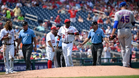 Washington Nationals manager Dusty Baker (12) and Jayson Werth, left, argue with umpires after a play where Werth was called out during the fourth inning of a baseball game against the New York Mets, Saturday, April 29, 2017, in Washington. Also seen is New York Mets starting pitcher Zack Wheeler (45). (AP Photo/Nick Wass)