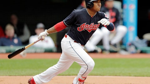 Cleveland Indians' Jose Ramirez watches his two-run double off Seattle Mariners starting pitcher Yovani Gallardo in the first inning of a baseball game, Saturday, April 29, 2017, in Cleveland. Carlos Santana and Francisco Lindor scored on the play. (AP Photo/Tony Dejak)