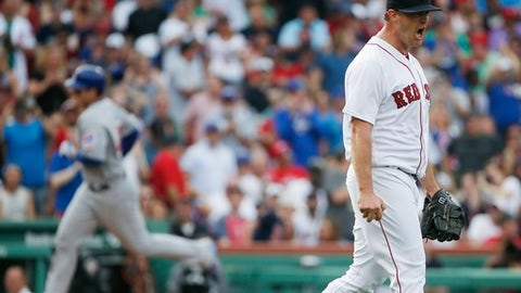 Boston Red Sox's Steven Wright, right, reacts after giving up a two-run home run to Chicago Cubs' Anthony Rizzo, left, during the fourth inning of a baseball game, Saturday, April 29, 2017, in Boston. (AP Photo/Michael Dwyer)