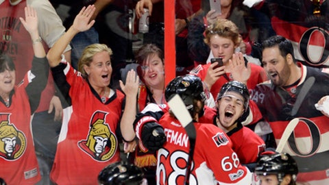 Ottawa Senators center Jean-Gabriel Pageau (44) celebrates his game-winning goal with left wing Mike Hoffman (68) against the New York Rangers during the second overtime of Game 2 of an NHL hockey Stanley Cup second-round playoff series Saturday, April 29, 2017, in Ottawa, Ontario. The Senators won 6-5. (Adrian Wyld/The Canadian Press via AP)