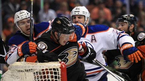 ANAHEIM, CA - APRIL 28:  Milan Lucic #27 and Connor McDavid #97 of the Edmonton Oilers push Josh Manson #42 of the Anaheim Ducks away from the goal mouth during the second period of Game Two of the Western Conference Second Round during the 2017  NHL Stanley Cup Playoffs at Honda Center on April 28, 2017 in Anaheim, California.  (Photo by Sean M. Haffey/Getty Images)