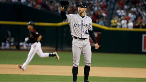 Colorado Rockies pitcher Tyler Anderson (44) receives a new baseball after giving up a two-run home run to Arizona Diamondbacks' Jake Lamb, left, during the fifth inning of a baseball game, Saturday, April 29, 2017, in Phoenix. (AP Photo/Ralph Freso)