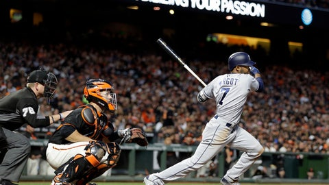 San Diego Padres' Manuel Margot, right, swings for an RBI-single off San Francisco Giants' Neil Ramirez in the sixth inning of a baseball game Saturday, April 29, 2017, in San Francisco. (AP Photo/Ben Margot)