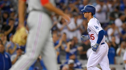 Los Angeles Dodgers' Cody Bellinger, right, rounds third as Philadelphia Phillies starting pitcher Zach Eflin walks off the mound during the seventh inning of a baseball game, Saturday, April 29, 2017, in Los Angeles. (AP Photo/Mark J. Terrill)