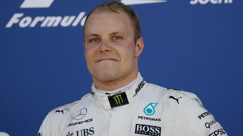 Mercedes driver Valtteri Bottas of Finland celebrates his victory at the Formula One Russian Grand Prix at the 'Sochi Autodrom' circuit, in Sochi, Russia, Sunday, April. 30, 2017. (AP Photo/Pavel Golovkin)
