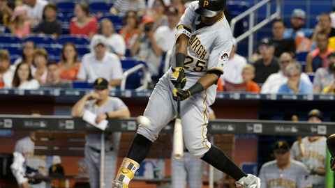 Pittsburgh Pirates' Gregory Polanco (25) hits a double during the first inning of a baseball game against the Miami Marlins, Sunday, April 30, 2017, in Miami. (AP Photo/Lynne Sladky)