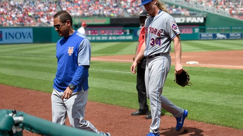 New York Mets starting pitcher Noah Syndergaard (34) leaves a baseball game with an injury during the second inning against the Washington Nationals, Sunday, April 30, 2017, in Washington. (AP Photo/Nick Wass)
