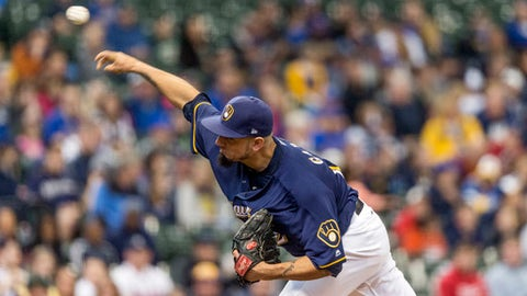 Milwaukee Brewers' Matt Garza pitches to an Atlanta Braves batter during the first inning of a baseball game, Sunday, April 30, 2017, in Milwaukee. (AP Photo/Tom Lynn)