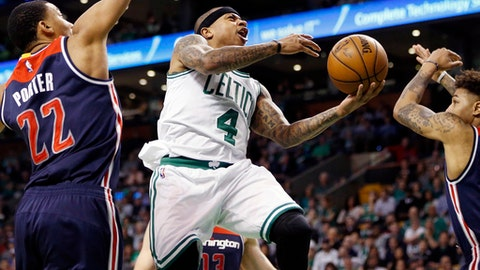 Boston Celtics' Isaiah Thomas (4) goes up to shoot against Washington Wizards' Otto Porter Jr. (22) during the second quarter of a second-round NBA playoff series basketball game, Sunday, April, 30, 2017, in Boston. (AP Photo/Michael Dwyer)