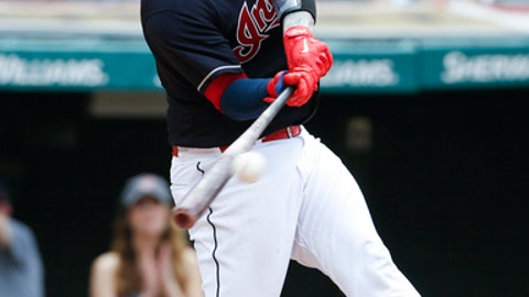 Cleveland Indians' Roberto Perez hits a two-run double off Seattle Mariners relief pitcher Dillon Overton during the seventh inning of a baseball game, Sunday, April 30, 2017, in Cleveland. The Indians won 12-4. (AP Photo/Ron Schwane)