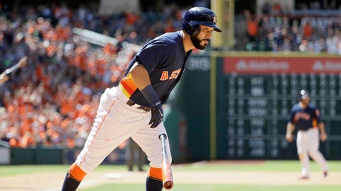 Houston Astros' Marwin Gonzalez tosses his bat after hitting a three-run home run against the Oakland Athletics during the eighth inning of a baseball game Sunday, April 30, 2017, in Houston. (AP Photo/David J. Phillip)