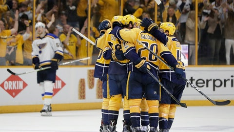Nashville Predators players congratulate defenseman Roman Josi (59), of Switzerland, after he scored a goal against the St. Louis Blues during the third period in Game 3 of a second-round NHL hockey playoff series Sunday, April 30, 2017, in Nashville, Tenn. (AP Photo/Mark Humphrey)