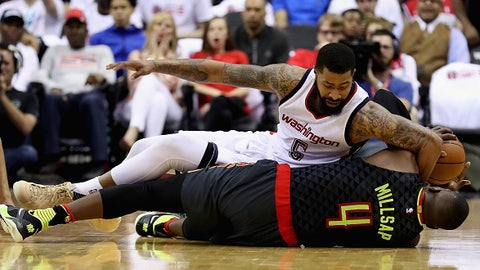 WASHINGTON, DC - APRIL 16:  Markieff Morris #5 of the Washington Wizards and Paul Millsap #4 of the Atlanta Hawks go after a loose ball in the first half in Game One of the Eastern Conference Quarterfinals during the 2017 NBA Playoffs at Verizon Center on April 16, 2017 in Washington, DC. NOTE TO USER: User expressly acknowledges and agrees that, by downloading and or using this photograph, User is consenting to the terms and conditions of the Getty Images License Agreement.  (Photo by Rob Carr/Getty Images)