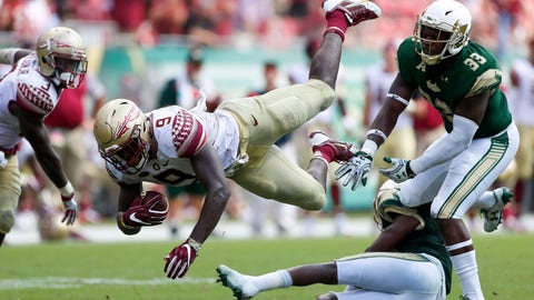 Sep 24, 2016; Tampa, FL, USA; Florida State Seminoles running back Jacques Patrick (9) dives forward in the second half as South Florida Bulls linebacker Cecil Cherry (33) defends in the second half at Raymond James Stadium. Florida State Seminoles won 55-35. Mandatory Credit: Logan Bowles-USA TODAY Sports