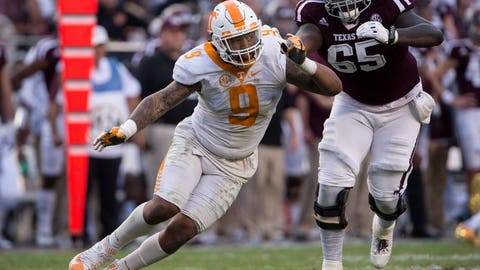 Oct 8, 2016; College Station, TX, USA; Tennessee Volunteers defensive end Derek Barnett (9) and Texas A&M Aggies offensive lineman Avery Gennesy (65) in action during the game at Kyle Field. The Aggies defeat the Volunteers 45-38 in overtime. Mandatory Credit: Jerome Miron-USA TODAY Sports