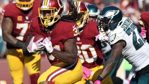 Oct 16, 2016; Landover, MD, USA; Washington Redskins running back Matt Jones (31) carries the ball past Philadelphia Eagles safety Malcolm Jenkins (27) chases in the fourth quarter at FedEx Field. The Redskins won 27-20. Mandatory Credit: Geoff Burke-USA TODAY Sports