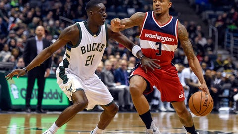 Jan 8, 2017; Milwaukee, WI, USA;  Washington Wizards guard Bradley Beal (3) drives for the basket against Milwaukee Bucks guard Tony Snell (21) in the first quarter at BMO Harris Bradley Center. Beal scored 26 points to help the Wizards beat the Bucks 107-101. Mandatory Credit: Benny Sieu-USA TODAY Sports