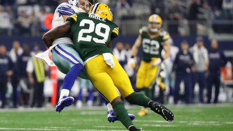 Jan 15, 2017; Arlington, TX, USA; Green Bay Packers defensive back Kentrell Brice (29) tackles Dallas Cowboys wide receiver Cole Beasley (11) during the second quarter in the NFC Divisional playoff game at AT&T Stadium. Mandatory Credit: Kevin Jairaj-USA TODAY Sports