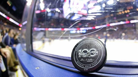 Feb 19, 2017; Columbus, OH, USA; A view of the NHL Centennial logo on an official NHL puck of the Columbus Blue Jackets after being hit into the crowd at Nationwide Arena. The Predators won 4-3. Mandatory Credit: Aaron Doster-USA TODAY Sports