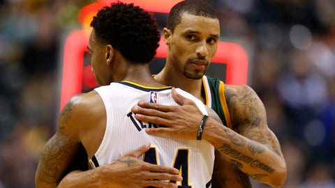 Mar 20, 2017; Indianapolis, IN, USA; Indiana Pacers guard Jeff Teague (44) and former Pacer and current Utah Jazz guard George Hill (3) embrace after the game at Bankers Life Fieldhouse. Indiana defeated Utah 107-100. Mandatory Credit: Brian Spurlock-USA TODAY Sports