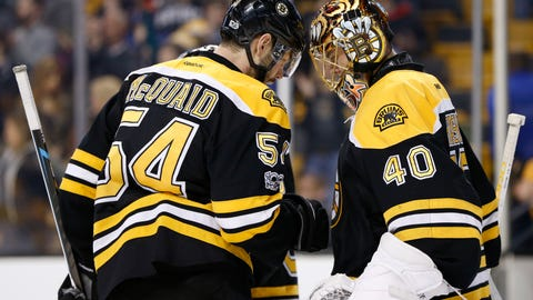 Mar 30, 2017; Boston, MA, USA; Boston Bruins defenseman Adam McQuaid (54) celebrates with goalie Tuukka Rask (40) after defeating the Dallas Stars 2-0 at TD Garden. Mandatory Credit: Greg M. Cooper-USA TODAY Sports