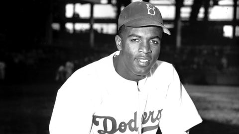 """FILE - In this April 11, 1947 file photo, Jackie Robinson of the Brooklyn Dodgers poses at Ebbets Field in the Brooklyn borough of New York. Robinson is the subject of a two-part documentary, """"Jackie Robinson"""" directed by Ken Burns, Sarah Burns and David McMahon airing Monday and Tuesday at 9 p.m. on most PBS stations.   (AP Photo/John Rooney, File)"""