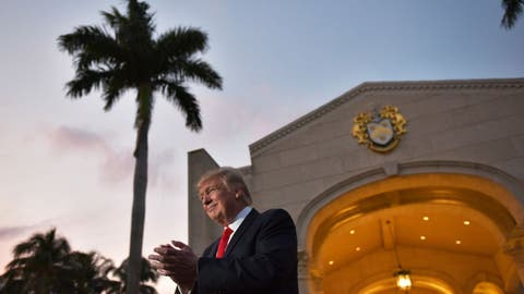 US President Donald Trump applauds as he is greeted by the Palm Beach Central High School marching band upon arrival to watch the Super Bowl at Trump International Golf Club Palm Beach in West Palm Beach, Florida on February 5, 2017. / AFP / MANDEL NGAN        (Photo credit should read MANDEL NGAN/AFP/Getty Images)