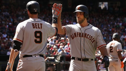 PHOENIX, AZ - APRIL 02:  Madison Bumgarner #40 of the San Francisco Giants high fives Brandon Belt #9 after Bumgarner hit a solo home run against the Arizona Diamondbacks during the fifth inning of the MLB opening day game at Chase Field on April 2, 2017 in Phoenix, Arizona.  (Photo by Christian Petersen/Getty Images)