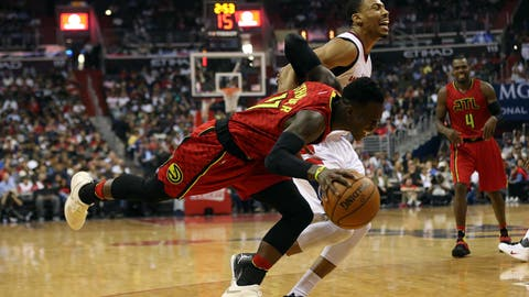 Apr 26, 2017; Washington, DC, USA; Atlanta Hawks guard Dennis Schroder (17) is fouled by Washington Wizards forward Otto Porter Jr. (22) while dribbling the ball in the second quarter in game five of the first round of the 2017 NBA Playoffs at Verizon Center. Mandatory Credit: Geoff Burke-USA TODAY Sports