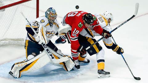 Apr 13, 2017; Chicago, IL, USA; Chicago Blackhawks center Jonathan Toews (19) battles for the puck with Nashville Predators defenseman Ryan Ellis (4)and goalie Pekka Rinne (35) during the first period in game one of the first round of the 2017 Stanley Cup Playoffs at United Center. Mandatory Credit: Kamil Krzaczynski-USA TODAY Sports