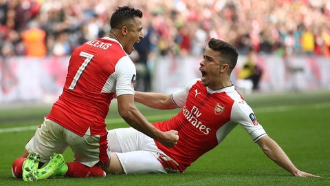 LONDON, ENGLAND - APRIL 23:  Alexis Sanchez (L) of Arsenal celebrates scoring his side's second goal with his team mate Gabriel (R) during the Emirates FA Cup Semi-Final match between Arsenal and Manchester City at Wembley Stadium on April 23, 2017 in London, England.  (Photo by Julian Finney/Getty Images,)