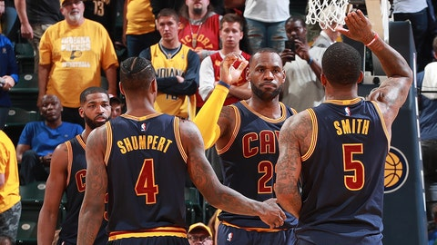 INDIANAPOLIS, IN - APRIL 23: LeBron James #23 of the Cleveland Cavaliers high fives teammates during the game against the Indiana Pacers during Game Four of the Eastern Conference Quarterfinals of the 2017 NBA Playoffs on April 23, 2017 at Bankers Life Fieldhouse in Indianapolis, Indiana. NOTE TO USER: User expressly acknowledges and agrees that, by downloading and or using this photograph, User is consenting to the terms and conditions of the Getty Images License Agreement. Mandatory Copyright Notice: Copyright 2017 NBAE (Photo by Jeff Haynes/NBAE via Getty Images)