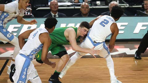 North Carolina's Joel Barry gets taken down.