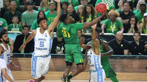 Dylan Ennis drives to the bucket.