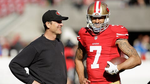 SANTA CLARA, CA - DECEMBER 28:  Head coach Jim Harbaugh of the San Francisco 49ers talks with Colin Kaepernick #7 before their game against the Arizona Cardinals at Levi's Stadium on December 28, 2014 in Santa Clara, California.  (Photo by Ezra Shaw/Getty Images)
