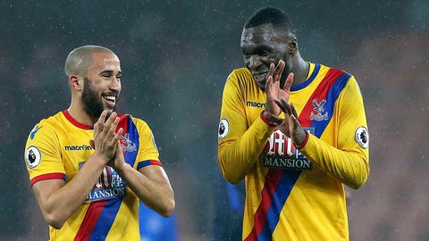 Crystal Palace's Andros Townsend, left and Christian Benteke celebrate after the English Premier League soccer match  between AFC Bournemouth and Crystal Palace, at the Vitality Stadium, Bournemouth, England, Tuesday, Jan. 31, 2017. (Andrew Matthews/PA via AP)